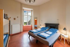 A bed or beds in a room at Stayokay Hostel Domburg