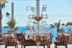 A restaurant or other place to eat at Atlantica Golden Beach Hotel - Adults Only