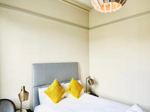 A bed or beds in a room at The Lovat Hotel