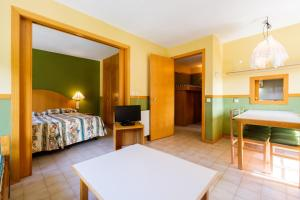 A bed or beds in a room at My City Home Baqueira - Solneu