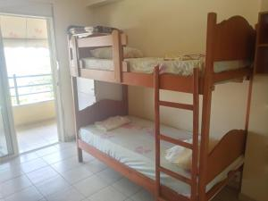 A bunk bed or bunk beds in a room at Saranda Backpackers