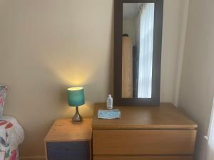 A bed or beds in a room at Guest House Finsbury Park