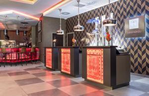 The lobby or reception area at Leonardo Hotel Dortmund