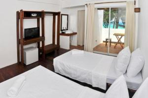A bed or beds in a room at Boracay Coco Huts