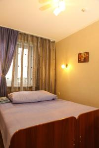 Кровать или кровати в номере Гостиница Аэлита