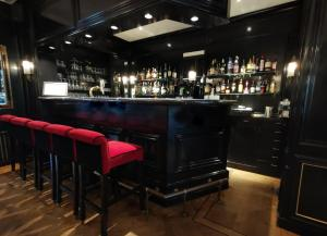 The lounge or bar area at Apollofirst Boutique Hotel