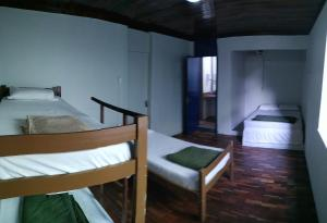 A bed or beds in a room at Da Orla Pampulha Hostel