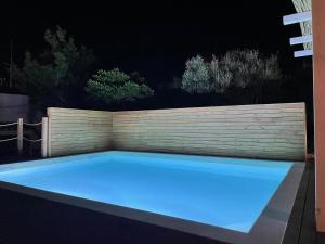 The swimming pool at or close to Dimora Ferralasco