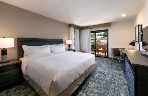 A bed or beds in a room at Best Western Seacliff Inn