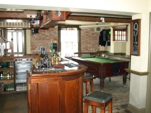 A pool table at Jolly Brewers Free House Inn
