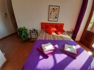 Säng eller sängar i ett rum på Ole Málaga