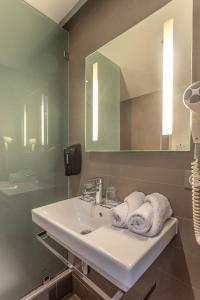 Un baño de ONOMO Hotel Rabat Medina