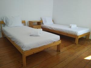 Uma cama ou camas num quarto em Baixa Terrace Hostel