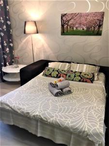 Кровать или кровати в номере Апартаменты Зелёный Город Бизнес Класс