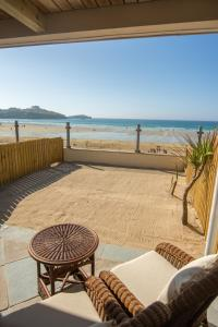 A balcony or terrace at Tolcarne Beach Colonial Restaurant and Rooms