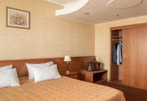 A bed or beds in a room at Cosmos Hotel