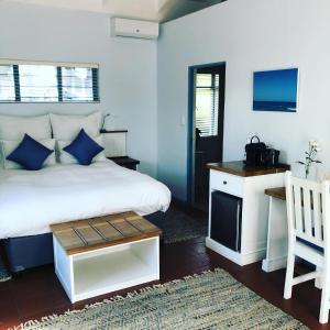 A bed or beds in a room at BlueSky Arniston Guest House