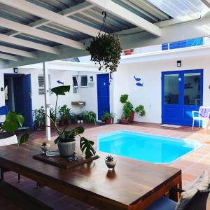 The swimming pool at or near BlueSky Arniston Guest House