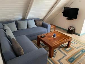 A seating area at BlueSky Arniston Guest House