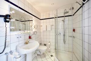Ein Badezimmer in der Unterkunft Weinromantikhotel Richtershof