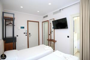 A bed or beds in a room at Hotel Semajo