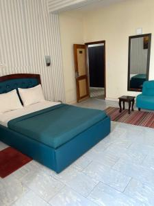 A bed or beds in a room at Hotel luxxor