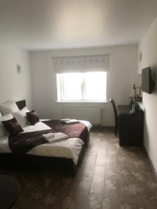 Кровать или кровати в номере База отдыха Зазерки
