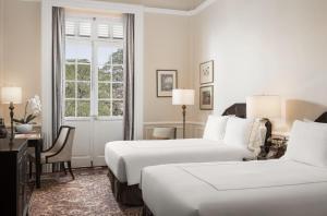Ein Bett oder Betten in einem Zimmer der Unterkunft Raffles Hotel Le Royal