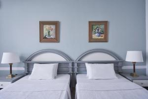 A bed or beds in a room at Labranda Sandy Beach