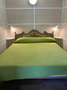 A bed or beds in a room at Camping Monja
