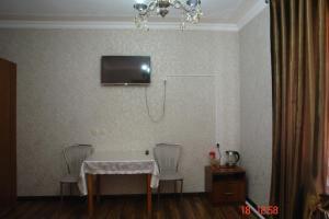 Телевизор и/или развлекательный центр в Hotel AMBO