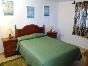 Säng eller sängar i ett rum på El Capistrano