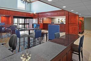 A restaurant or other place to eat at Comfort Suites Outlet Center