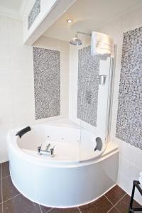A bathroom at Grand St Leger Hotel