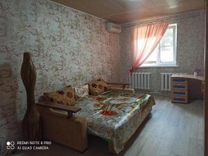 Кровать или кровати в номере House Krasnodarskaya 3
