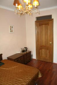 Кровать или кровати в номере Guest House Griboedova 12