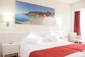 Cama o camas de una habitación en Hotel Bella Playa & Spa