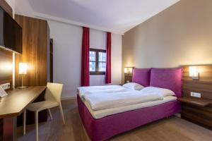 A bed or beds in a room at Trip Inn Eden Antwerpen