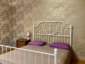 Кровать или кровати в номере Апартаменты на ул. Восход 21