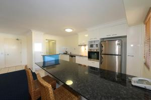 A kitchen or kitchenette at Coral Sands by Kacys