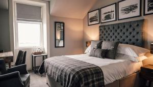 A bed or beds in a room at The Kirkwall Hotel