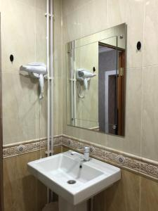 Ванная комната в Hotel AMBO