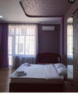 Кровать или кровати в номере Kamar Hotel Ijevan