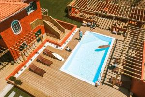 A view of the pool at Villa in Ribamar, Ericeira or nearby