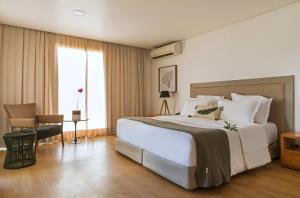 Cama ou camas em um quarto em Pousada Morena