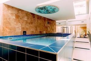 The swimming pool at or near Grand Hotel Karel V