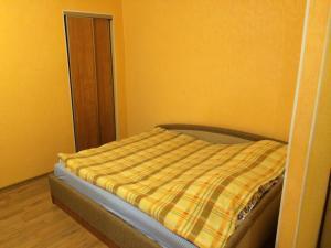 Кровать или кровати в номере Апартамент Чудинцева 7