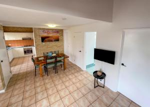 A television and/or entertainment center at Yot Spot Apartments