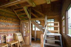 A bunk bed or bunk beds in a room at Auru Cīruļi