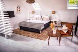 Een bed of bedden in een kamer bij Nobel Hotel